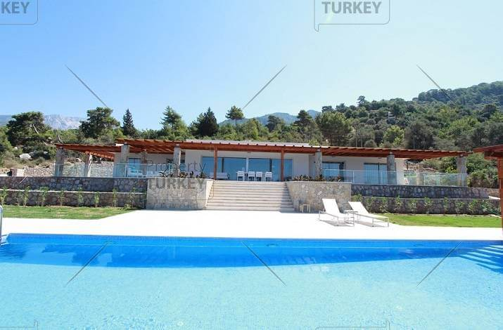 Seafront house in Faralya on large private grounds