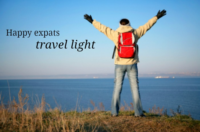 Happy expats travel light