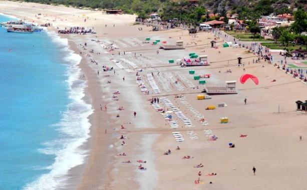 Tourists sunbathing at Oludeniz