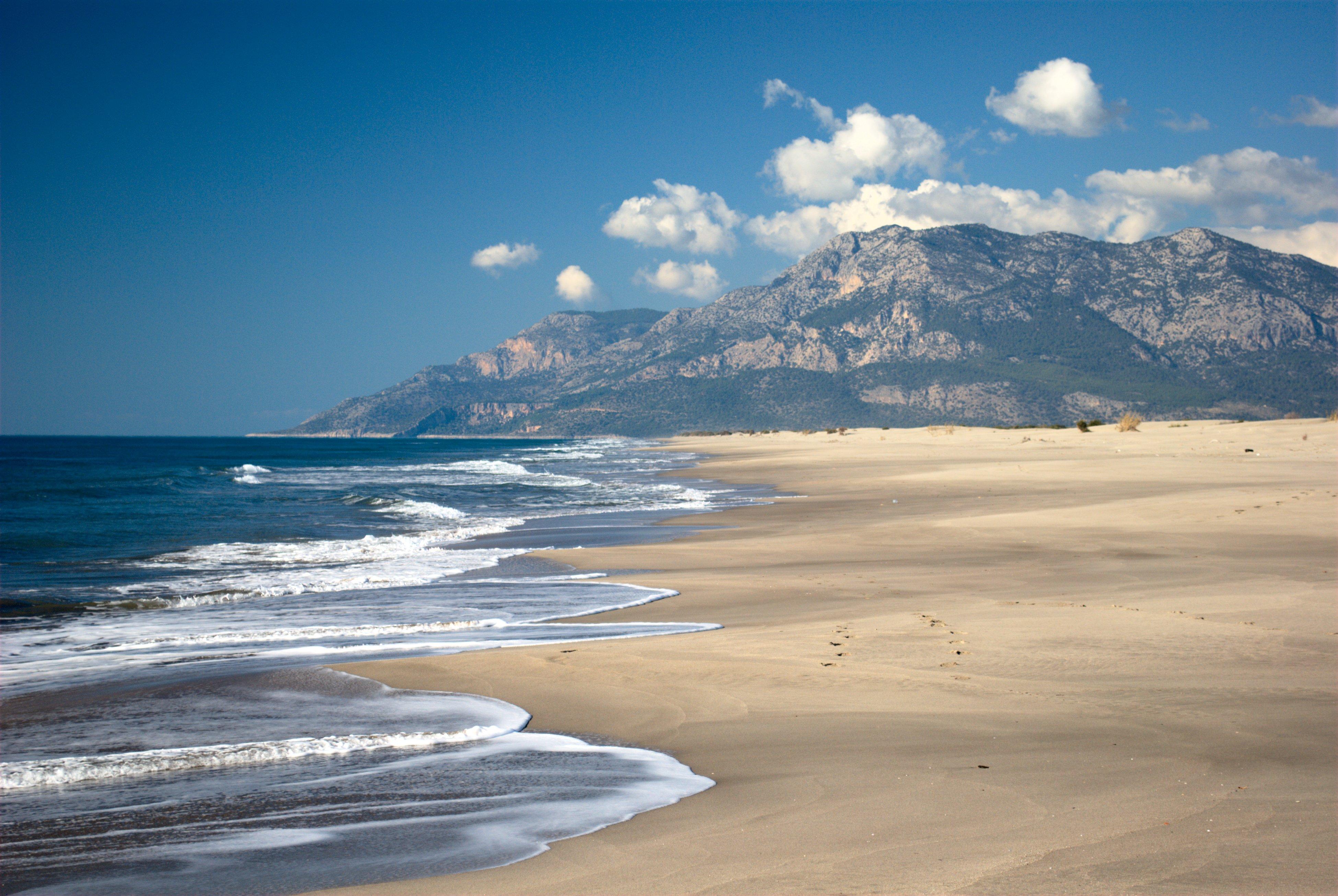 a seashore and mountains