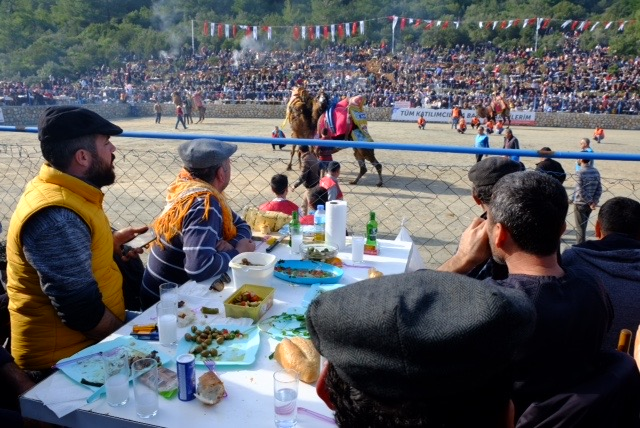 Local Turks bring their own picnics to enjoy while cheering on the camels.