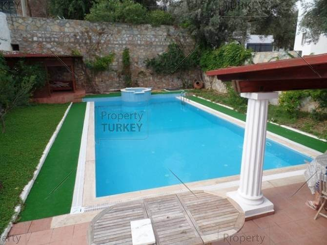 Poolside area in Torba home