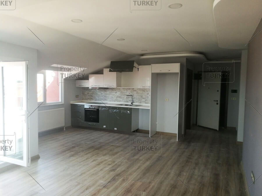 Kitchen and front room