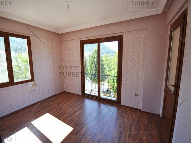 Spacious wooden floor room
