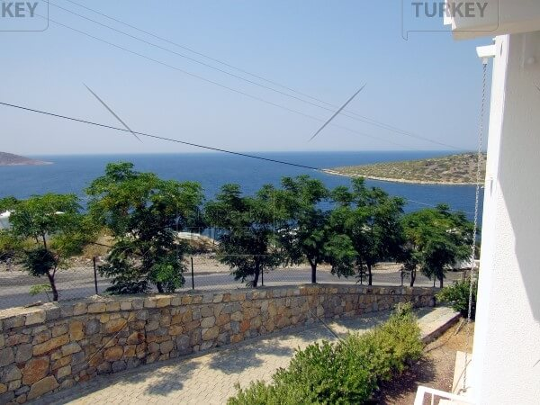 Gumusluk apartment with sea views for sale