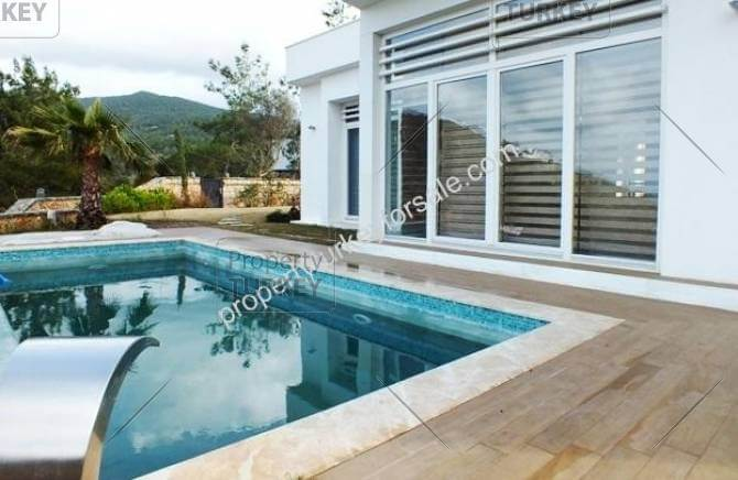 Swimming pool with decking area