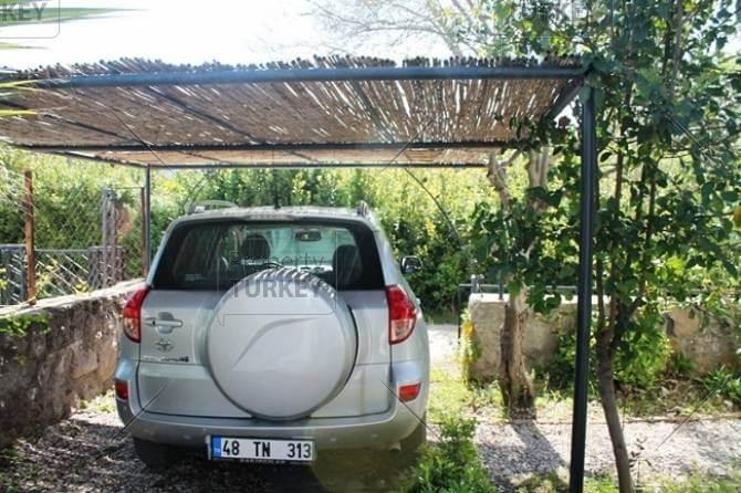 Carport in garden