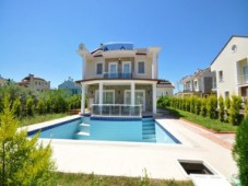 Detached villa with pool for sale in Calis